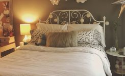 Decorative Metal Bed and Paper Flowers On Bedroom Wall Decor Ideas Above Bed